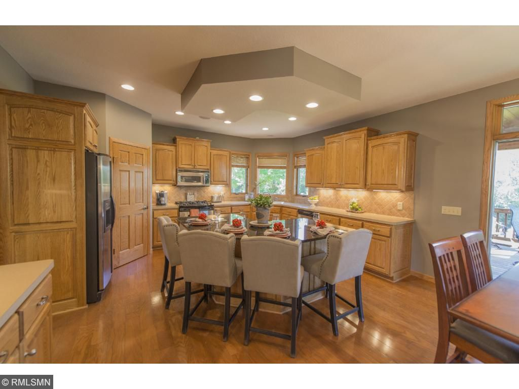 Chef's kitchen includes a beautiful island, large walk in pantry, stainless steel appliances, gas range, and that view! Watch wild turkeys, Blue Jays, and deer from your kitchen window.
