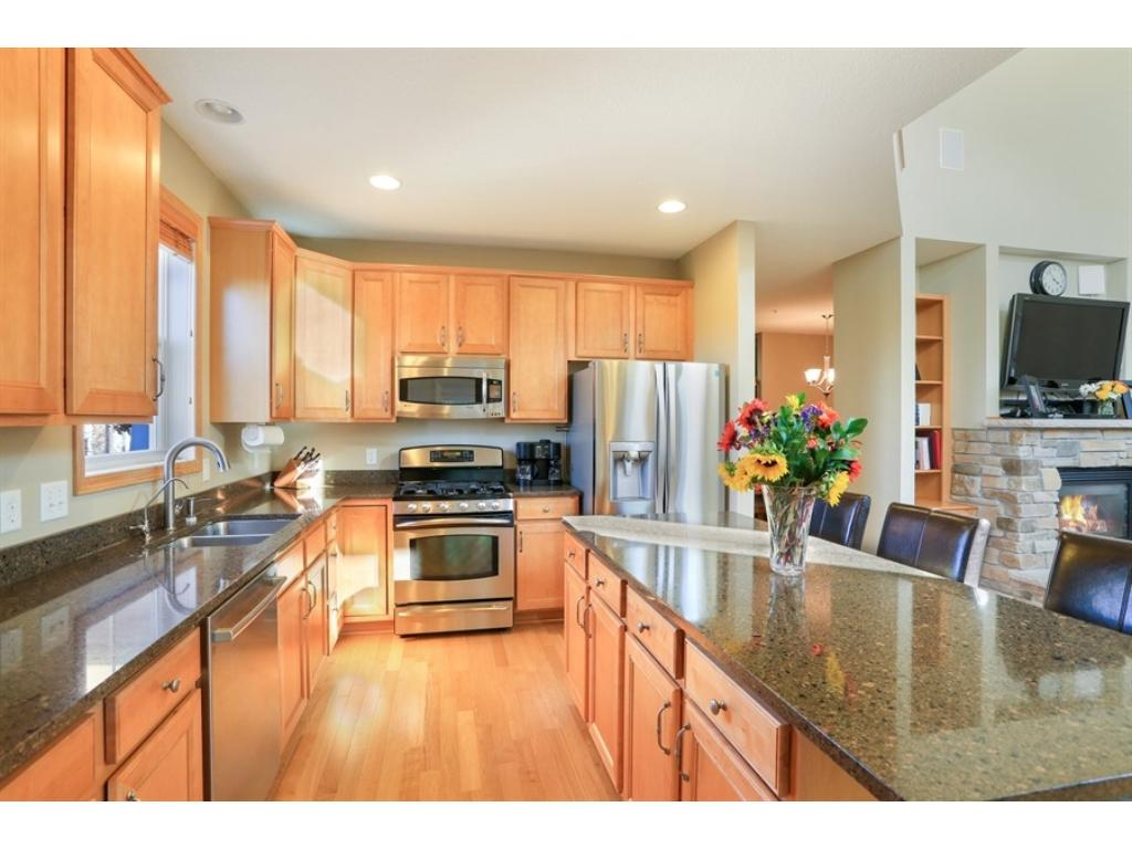 Notice the custom cabinets - beautiful wood floor and everything feels so open - great area for entertaining!