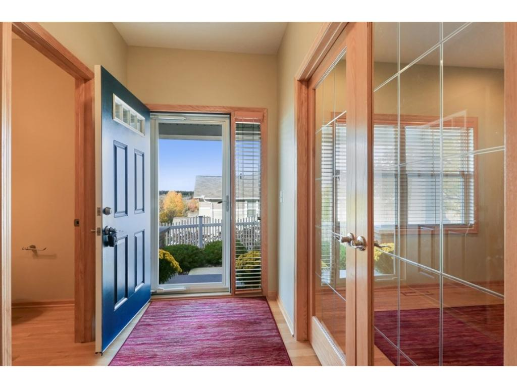 Grand entrance - real hardwood floors, main floor office, huge entry closetand French doors!