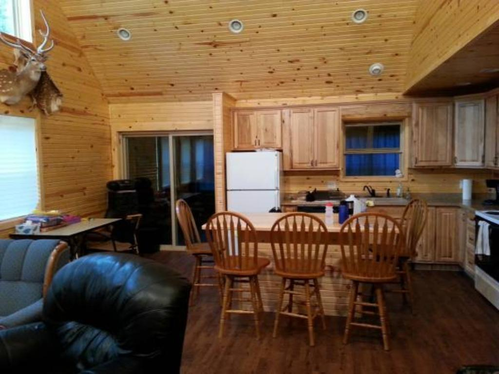 Open vaulted floor plan w/ gorgeous tongue & groove pine thru-out! There is a large center island kitchen/dining room & living room w/ plenty of space for entertaining! Full suite of appliances includes a refrigerator, range, microwave & dishwasher.