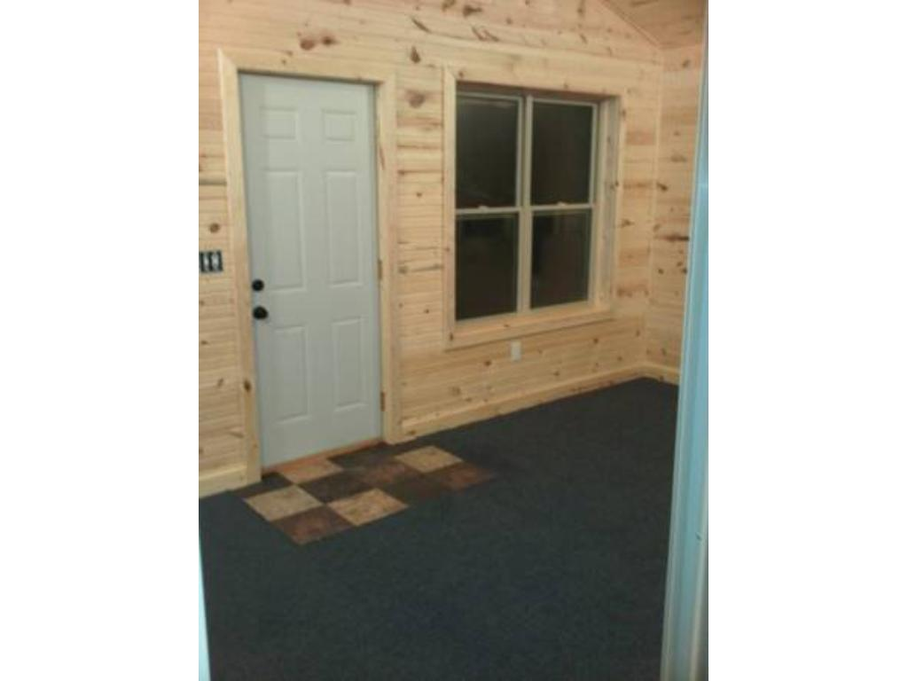 20 x 10 ft. 4-seasons porch offers large windows and supplemental baseboard heat. There is also a 2nd home entrance/exit.