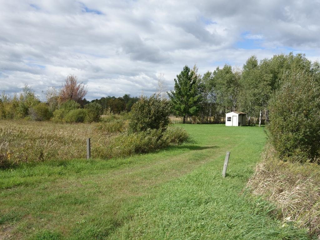 Welcome to your own private getaway!  The driveway enters off of Beroun Crossing (Cty. Rd. 14) to a mowed area for memorable gatherings.