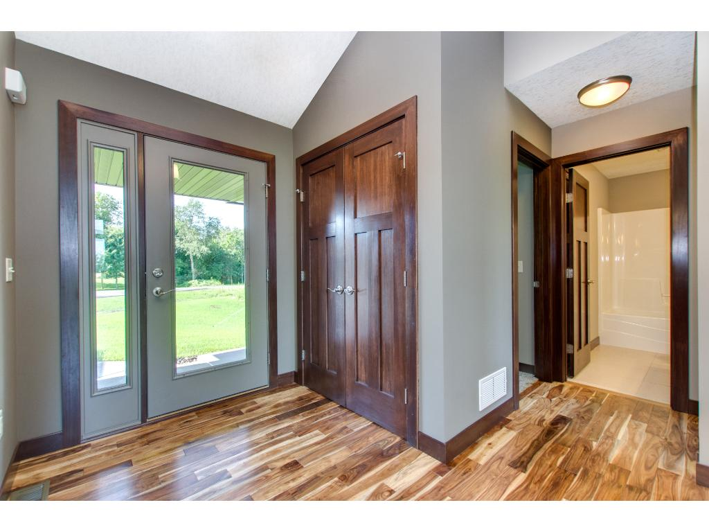 Spacious and bright foyer with an entry closet.