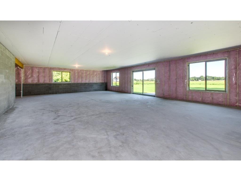 The lower level is a walk out and there is a sliding glass door for access to the back yard.