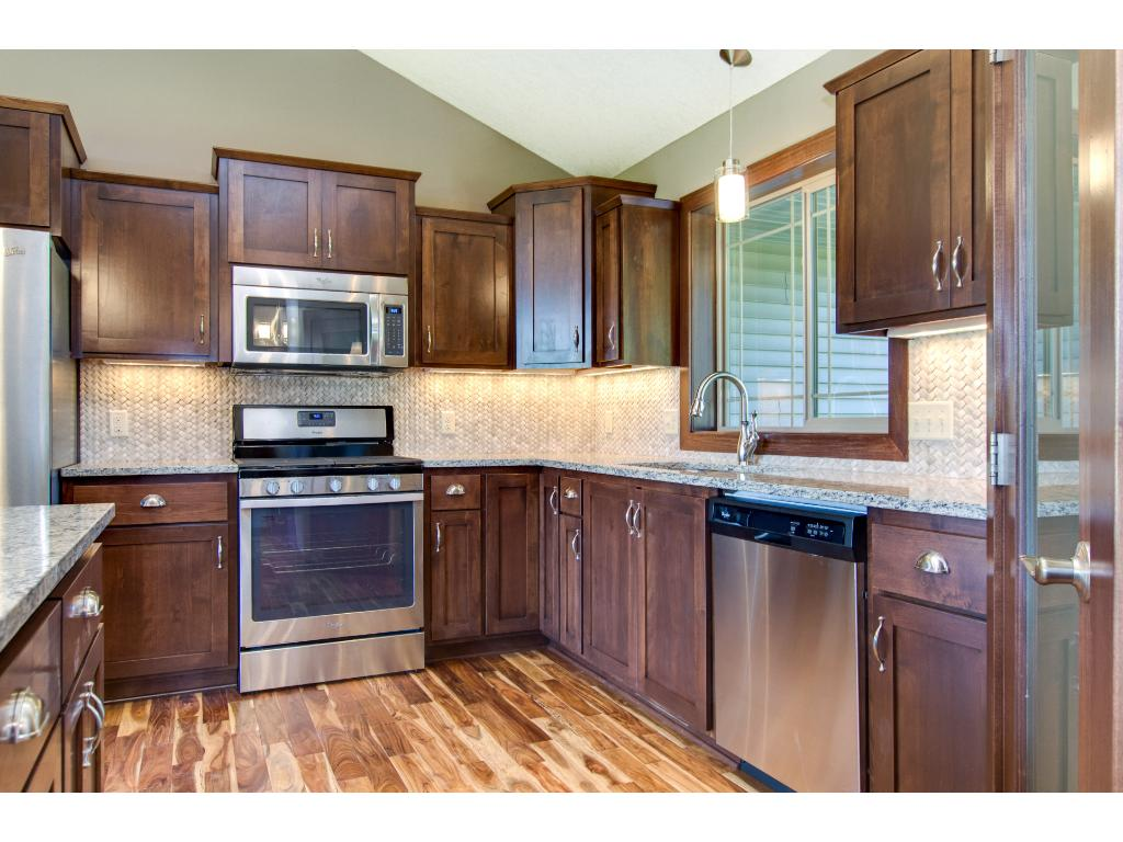 The kitchen has Stainless steel appliances, Granite counter tops and an abundance of Clear Alder cabinetry.