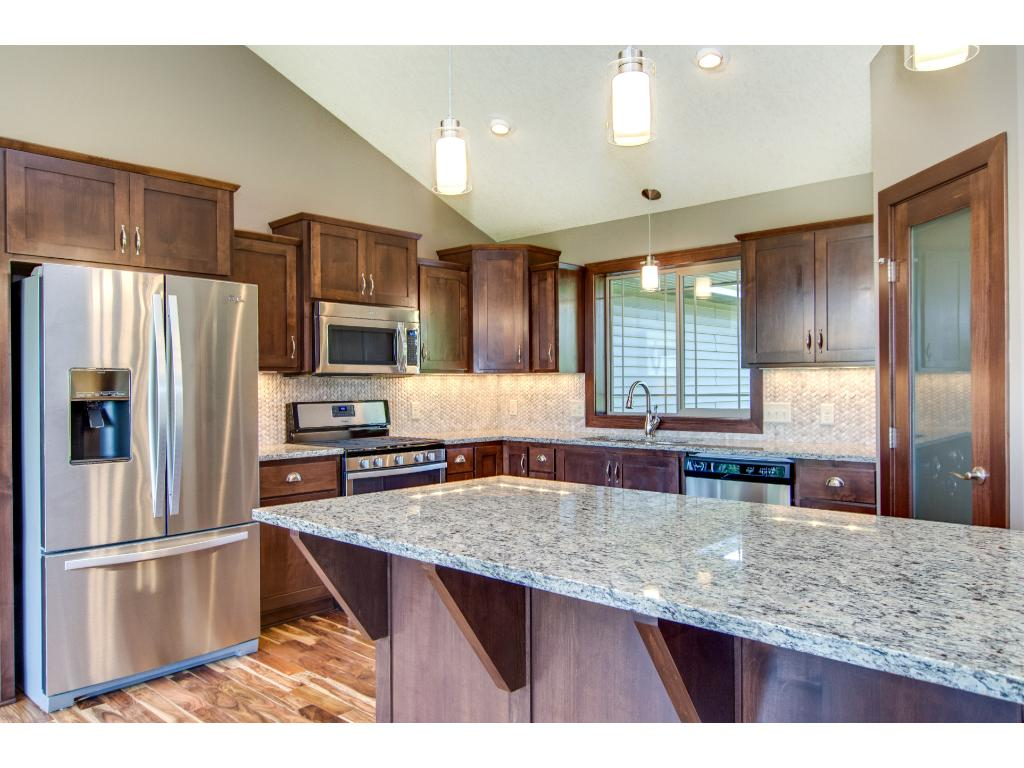 Oversized Granite topped kitchen island with space for breakfast seating.