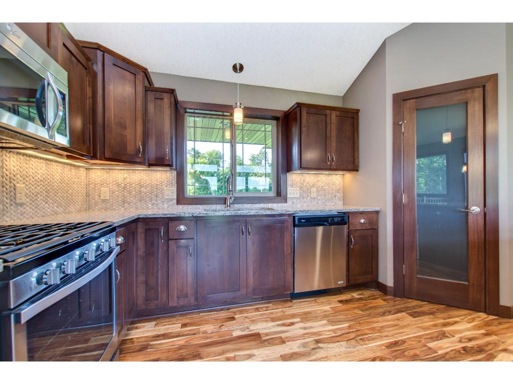 The kitchen also has a pantry closet, pendant and  under cabinet lighting.