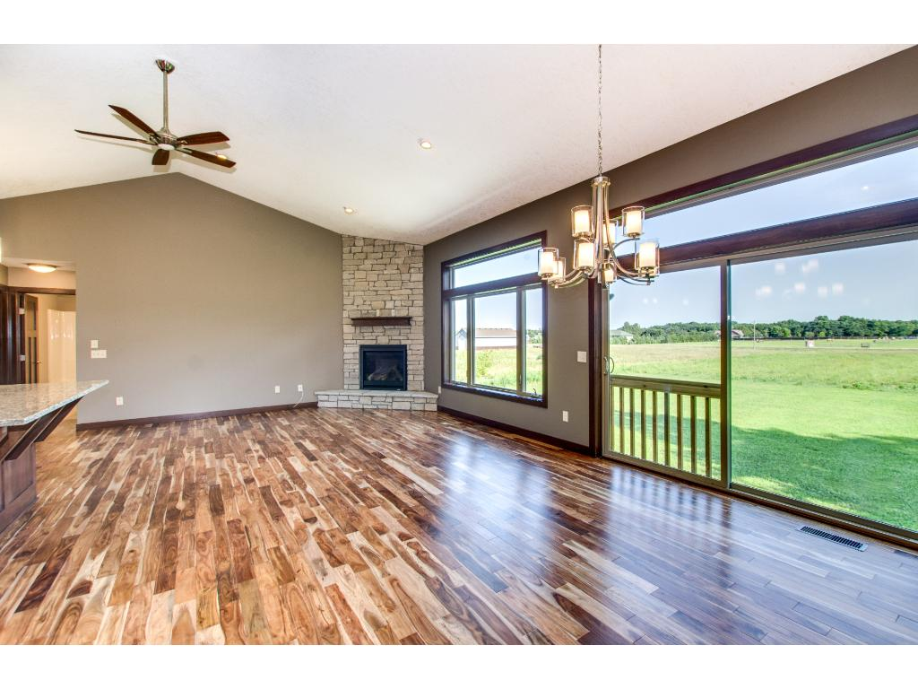 The informal dining area has a sliding glass door to a future deck.