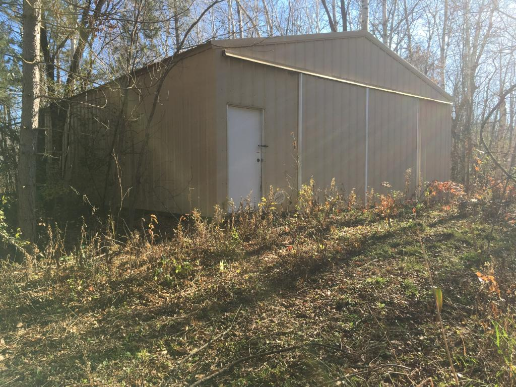 40 pond front acres with nice Menards pole building. Pole building is 20'x 30' and located about in the middle of the property.
