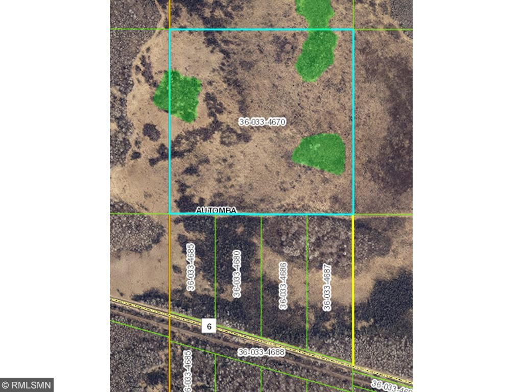 Aerial view of property showing boundary lines and wooded and wetland areas. Yellow line heading south from property to road is the easement to access land.