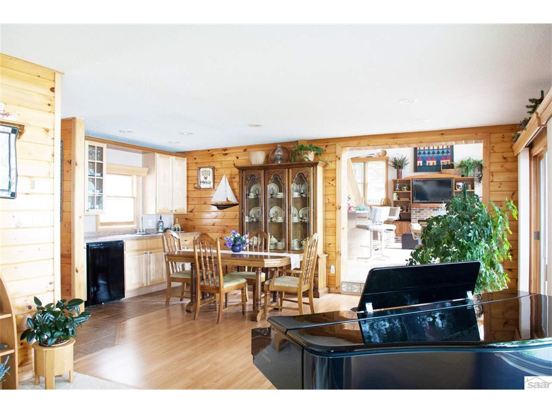This bright living room features expansive lake views. 11683 E. Point Rd., Lake Nebagamon, WI