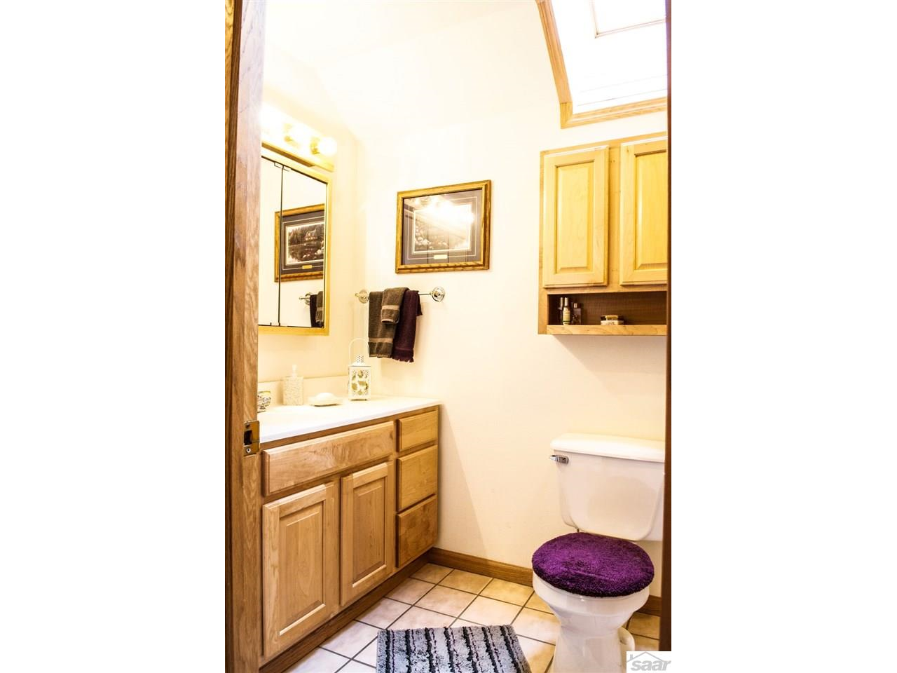 The upper level bathroom is privately located within the guest suite. 11683 E. Point Rd.,