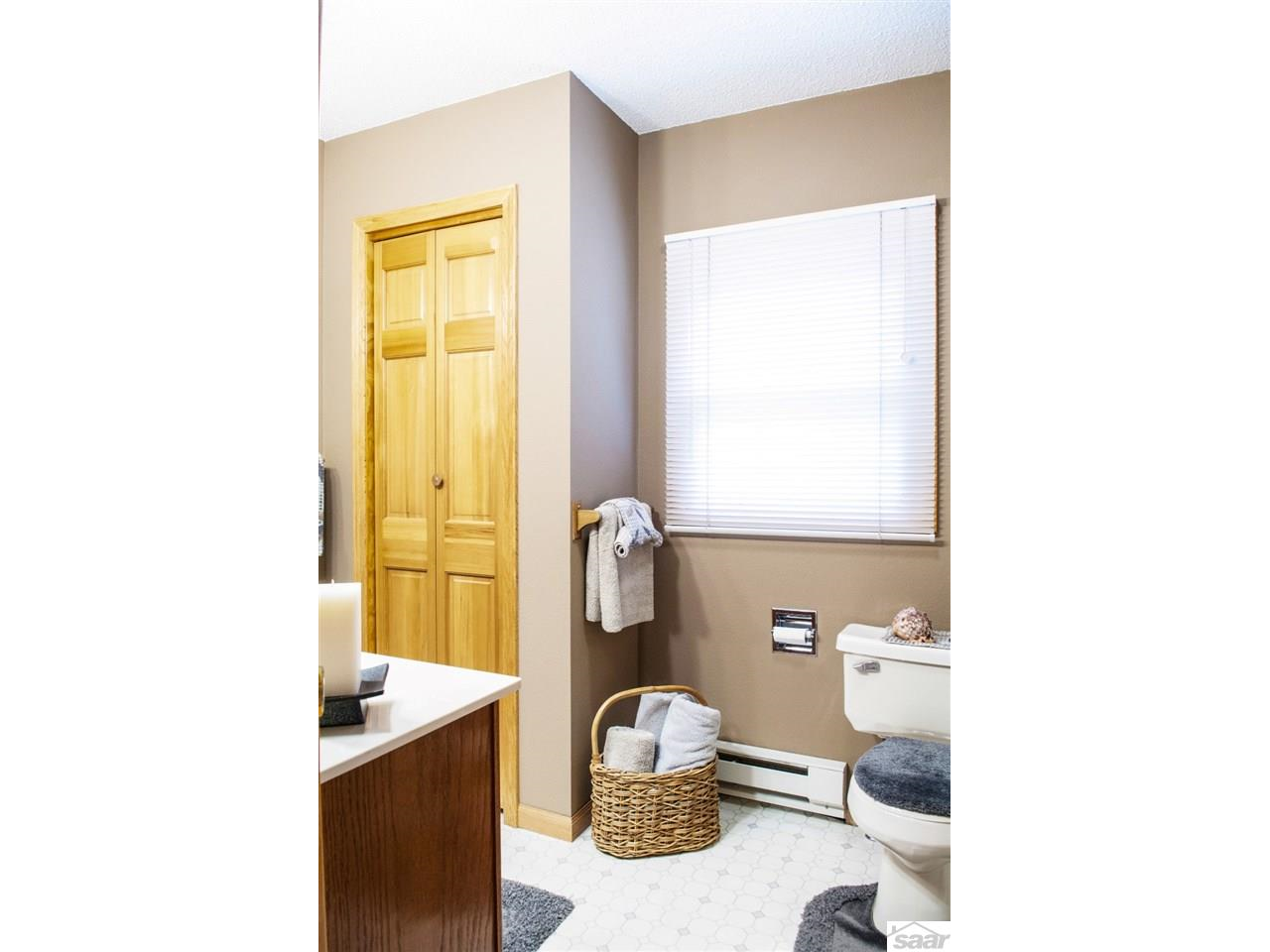 This main-floor bathroom is conveniently located near the bedrooms. 11683 E. Point Rd.,