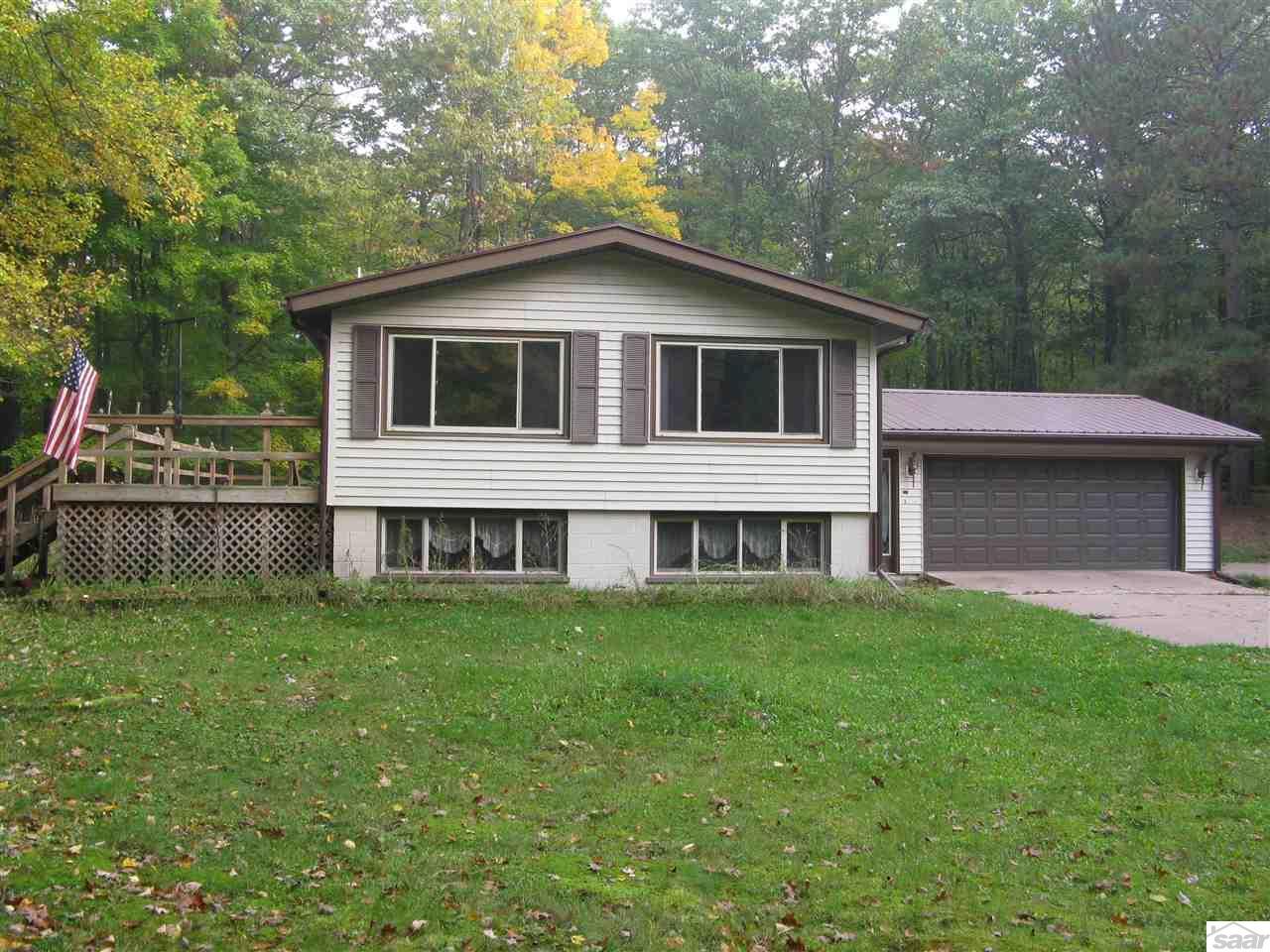 Great windows, large deck & attached garage