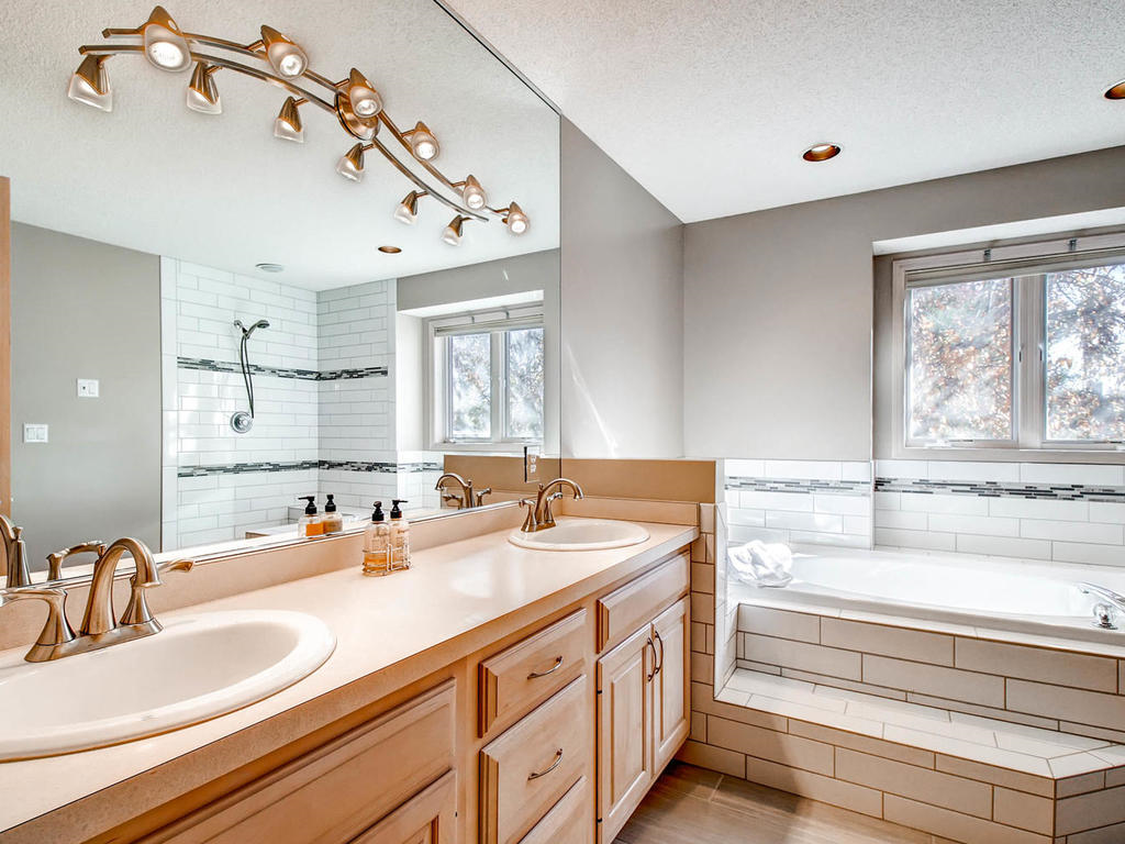 Master suite features double sink and huge mirror